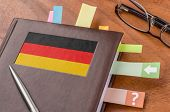 Notebook on a desk with the flag of Germany