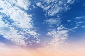 Blue And Pink Gradient Of Cloudy Sky Background