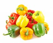 Pile of colorful bell peppers isolated