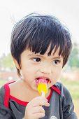 Asian Thai Little Boy Eating Ice Cream