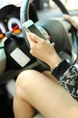 stock photo of unsafe  - Driving and using cellphone is dangerous and unsafe for other people - JPG