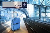 Departure For Lyon, France. Blue Suitcase At The Railway Station
