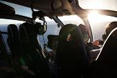 image of helicopters  - inside a helicopter or chopper with a pilot at dawn