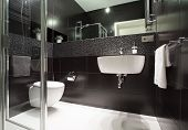 stock photo of wash-basin  - Luxury and modern bathroom in the apartment - JPG