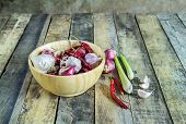Garlic,onions,dry Pepper And Lemon Grass In Wooden Bowl