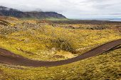 Dirt road in Icelandic landscape.