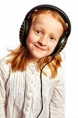 Girl With Headphones In A Light Top View
