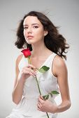 Woman with perfect skin holding rose