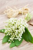 picture of lillies  - fresh lilly of the valley flowers on wooden background - JPG