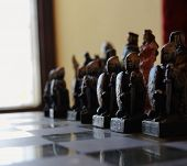 Vintage chess knight on a chessboard