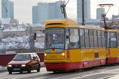Tram We Go On The Bridge Through Vistula In Warsaw.