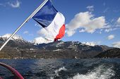 picture of annecy  - Annecy Lake and mountains from boat and French flag - JPG