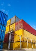 Colorful Industrial Cargo Containers. Vertical Photo