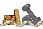 Fitness dumbbells with muesli bars and measuring tape