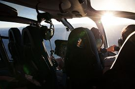 picture of helicopter  - inside a helicopter or chopper with a pilot at dawn