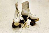 foto of roller-skating  - Old worn roller skates with big shoe - JPG