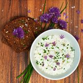 stock photo of chive  - Organic rye bread with fresh chives and cottage cheese square image - JPG