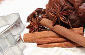 stock photo of christmas cookie  - Spice for baking anise and cinnamon cookie cutters dough for gingerbread and Christmas cookies lying on white flour concept for baking and christmas time - JPG