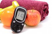 stock photo of diabetes  - Glucose meter fresh fruits dumbbells and purple towel for using in fitness concept for diabetes lifestyle and healthy nutrition - JPG