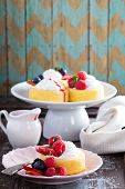 stock photo of fill  - Pastry cups filled with whipped cream and fresh berries - JPG