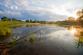 foto of fishing bobber  - Fishing tackle in a pond in early morning - JPG