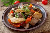 image of liver fry  - Roast chicken liver with vegetables on wooden background - JPG