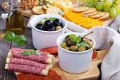 picture of cheese platter  - Variety of appetizers on dinner table salami - JPG