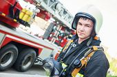 image of fire brigade  - firefighter in uniform in front of fire engine machine and fireman team - JPG