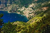 stock photo of beach-house  - view of Positano from the path of the gods with the tiny beach and colorful houses located on the rock Amalfi coast Italy - JPG