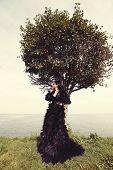 image of evil queen  - Fashion woman posing near the sea - JPG