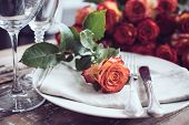 pic of wedding table decor  - Vintage table setting with glasses and cutlery on an old wooden board, wedding table decor