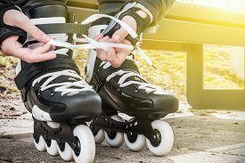 foto of inline skating  - dressing roller skates for skating - JPG