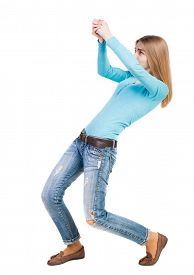 picture of roping  - back view of standing girl pulling a rope from the top or cling to something - JPG