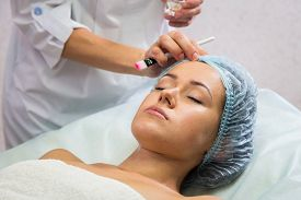 stock photo of cosmetology  - Girl with a beautician at spa salon - JPG