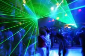 stock photo of laser beam  - Dancing Party at Disco music and laser show - JPG