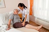 stock photo of caring  - a nurse in aged care for the elderly in nursing homes - JPG