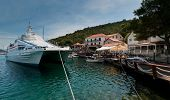 stock photo of family vacations  - Big boat tied at the dock in small town in the Adriatic sea - JPG