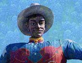 Big Texas Cowboy With Bluebonnet Background