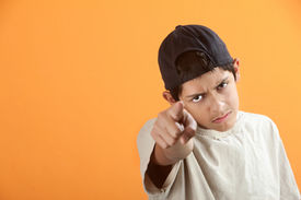 picture of teenage boys  - Serious or angry Latino kid points index finger - JPG