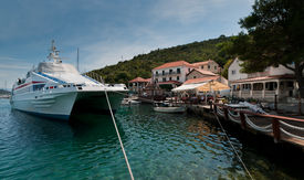 foto of family vacations  - Big boat tied at the dock in small town in the Adriatic sea - JPG