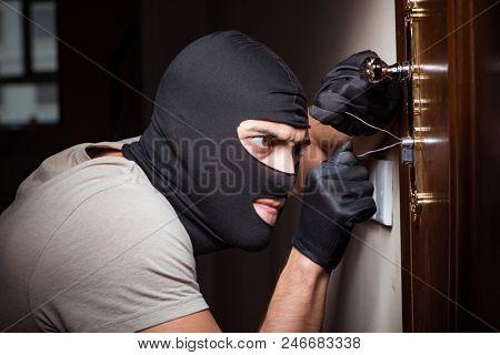 Burglar wearing balaclava mask at