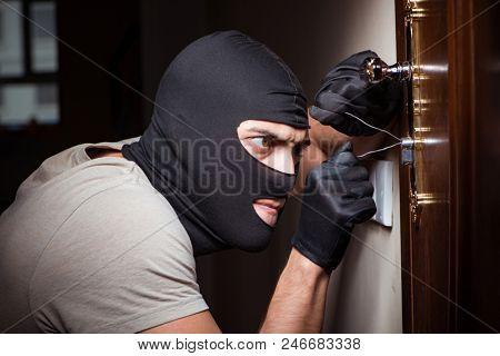 Burglar wearing balaclava mask at