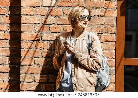 Girl With Mobile Phone In
