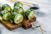 Low Carb Sushi Alternative - Cucumber Sushi With Salmon And Avocado, Copy Space poster