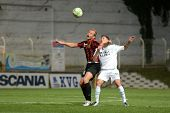 KAPOSVAR, HUNGARY - OCTOBER 15: Benjamin Balazs (in white) in action a Hungarian National Championship soccer game - Kaposvar (white) vs Honved (red) on October 15, 2011 in Kaposvar, Hungary.
