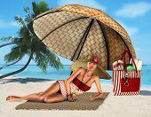 woman on a tropical beach under umbrella