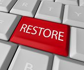 A keyboard with a red key for the word Restore, representing the need to return to past values or re