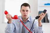 Businessman overextended with the phone