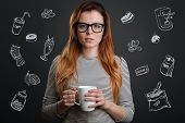 Drinking Coffee. Sleepy Young Woman Standing Alone With A Cup Of Coffee In Her Hands And Looking Sle poster