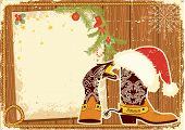 Billboard Frame With Cowboy Boots And Santa's Red Hat On Wood Wall.vintage